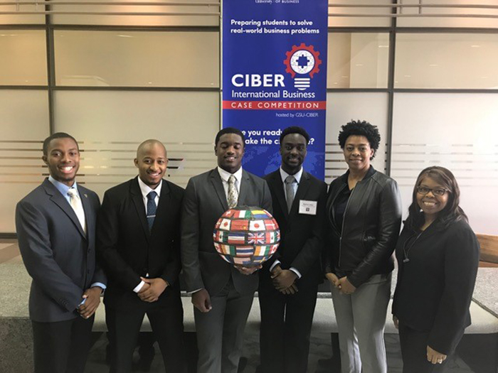 Four Golden Bulls traveled to Georgia State University March 8-9, 2018, to attend the Center for International Business Education & Research (CIBER) International Case Competition - Anthony Jefferson '19, a marketing major; accounting majors Caleb Letele '18 and Bedrick Yobo '18; and finance major Basir Wright '19 were accompanied to Atlanta by Prof. Yvette Hall, Interim Chair of the Department of Business Administration and Economics, and Dr. Maureen Leary, assistant professor of accounting.