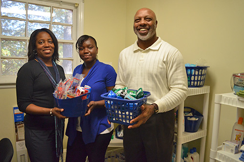 Chaplain Kanita McGahee, JCSU student Nilfia Hazel and Spiritual Life Center Director Donnie Shell open the Care Closet to students in need.