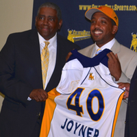 Stepher Joyner Jr. (center), stands with Dr. Carter (right) and his father and JCSU Athletics Director Stephen Joyner Sr., at the announcement.