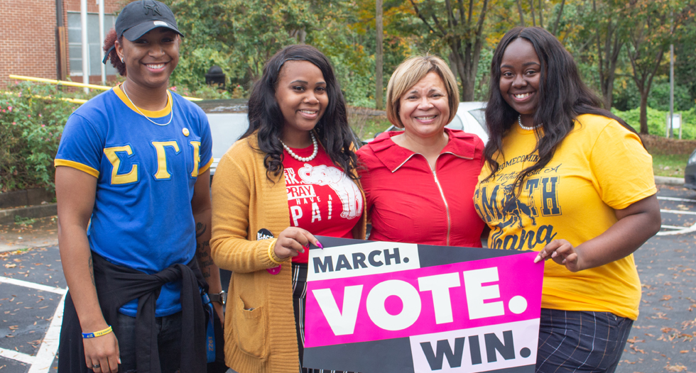 JCSU students ran into Charlotte Mayor Vi Lyles (C-Rt.) during their Bulls March to the Polls event during Election Day.